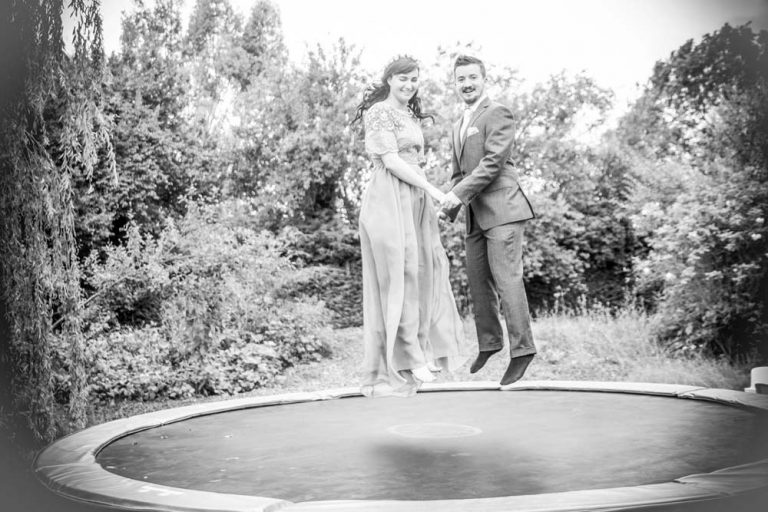 bride and groom on trampoline