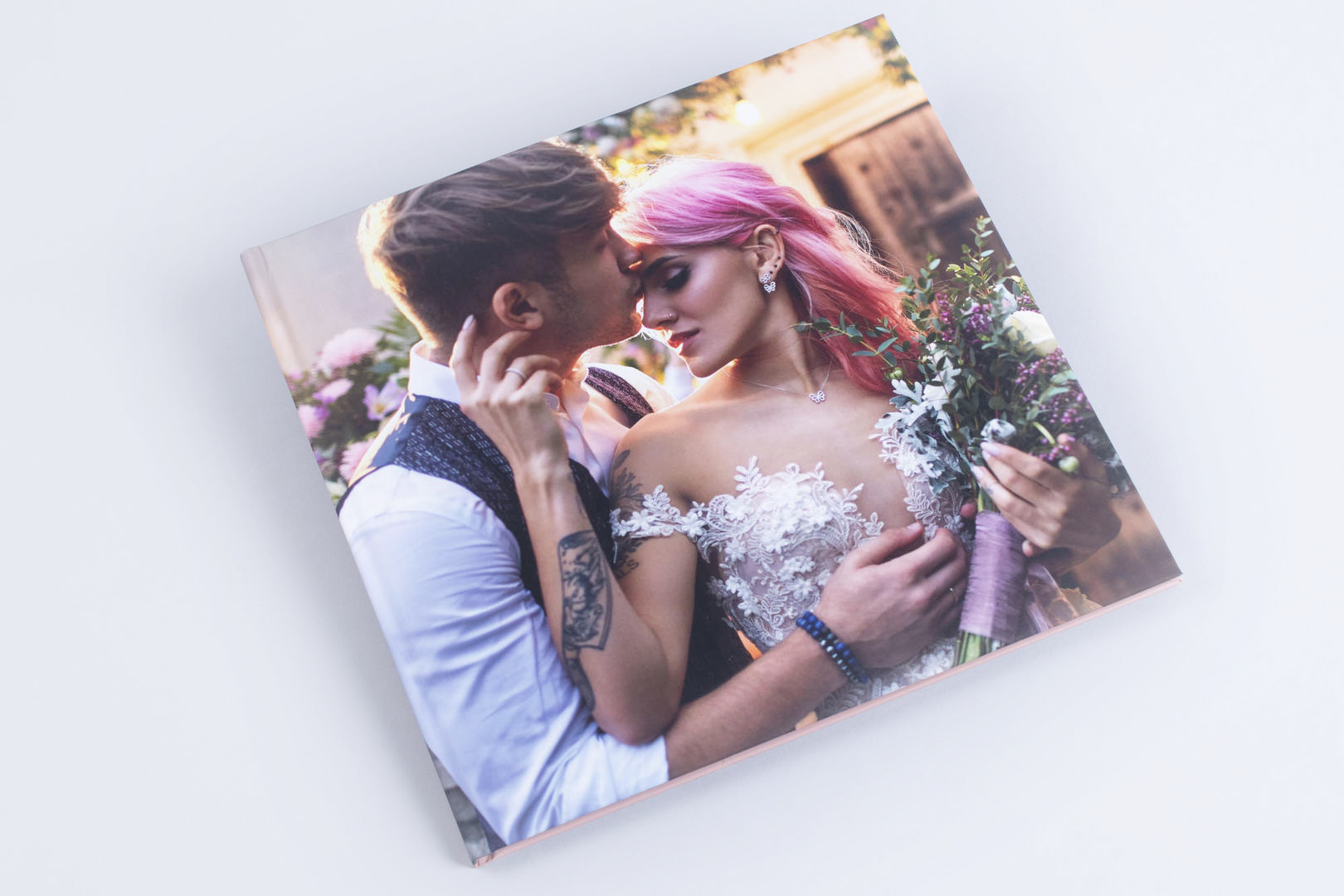 Photo book with printed cover wrap cover wedding photographer elopement simple professional product soft paged